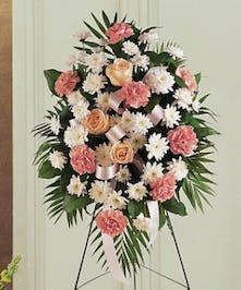 Pink and white standing easel spray of funeral flowers.