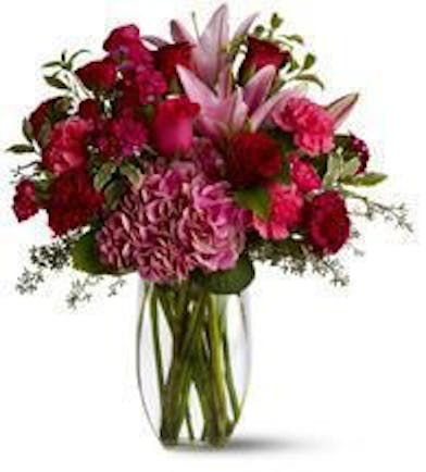 All pink flower arrangement in a clear glass vase.