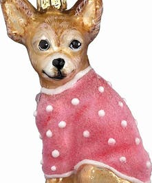 Brown chihuahua dog ornament with pink coat.