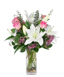 Perfect white Oriental Lilies mixed with Perfect Pink roses.