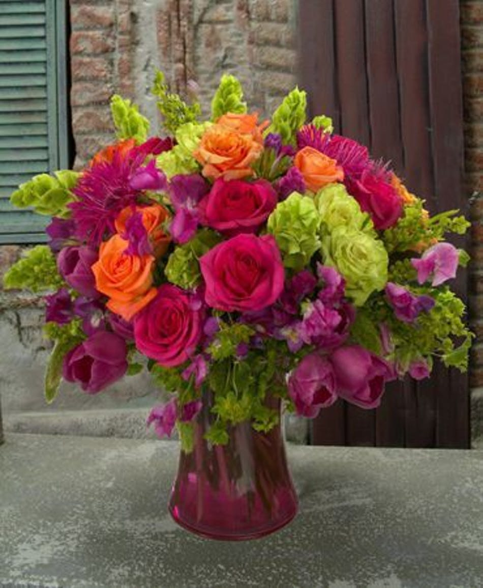 Hollywood fl flower delivery eye candy flowers als florist pink green and orange roses and holland flowers in a red glass vase izmirmasajfo