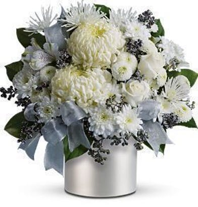 White and light blue flowers with silver accents in a silver vase