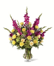 Sympathy Vase filled with beautiful yellow roses, green hydrangea with shades of purple accent flowers.