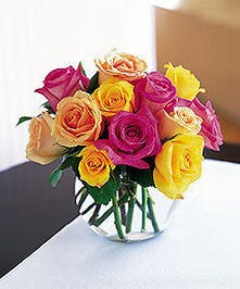 Multi colored roses in a bubble bowl vase.