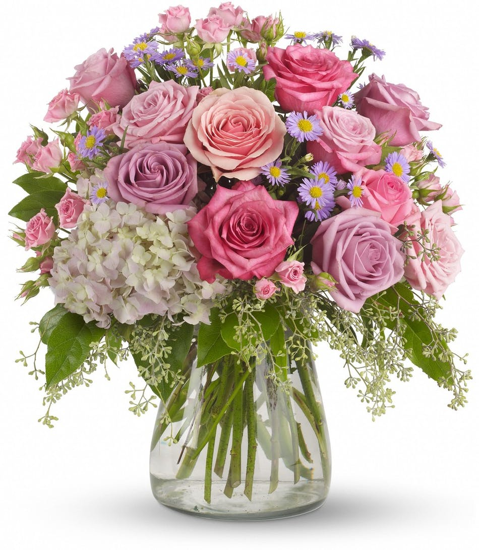 Hollywood fl flower delivery pink lavender roses als florist pink and lavender roses and light pink hydrangea in a clear glass vase izmirmasajfo
