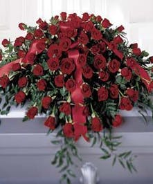 Casket spray made entirely of red roses.