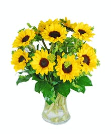 Bunch of sunflowers in a clear glass vase.