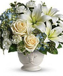 Blue and white flowers delivered in a French country style pot