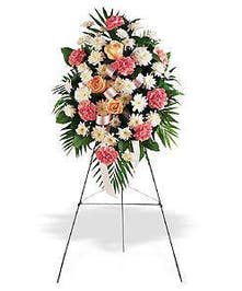 Standing easel funeral flowers spray of pink and white flowers.