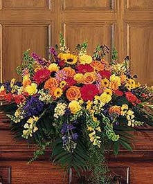 The vibrant colors of these flowers celebrate a life filled with joy, compassion, and love.