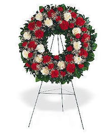 This vivid red and white wreath honors a loved one by sharing a timeless message of hope.