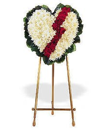 White and red broken heart floral arrangement suitable for a funeral service.