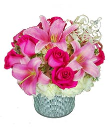 Hot pink roses, pink oriental lilies, and hydrangea in a blinged vase highlighted with a glittering crown.