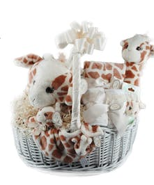 Basket filled with items for a newborn baby.