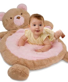 Baby mat in the shape of a teddy bear.