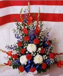 Red, white and blue flower arrangement with coordinating ribbon.