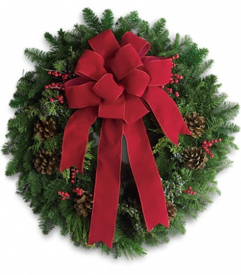 Fir wreath with juniper branches, pine cones, berries and red ribbon.