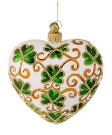 White heart-shaped ornament adorned with green shamrocks and gold accents.