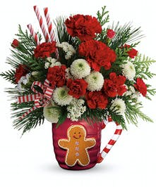 Gingerbread mug filled with carnations, chrysanthemums, and more in a holiday bouquet.