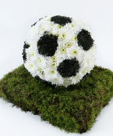 Soccer ball made of flowers for a funeral or memorial service.
