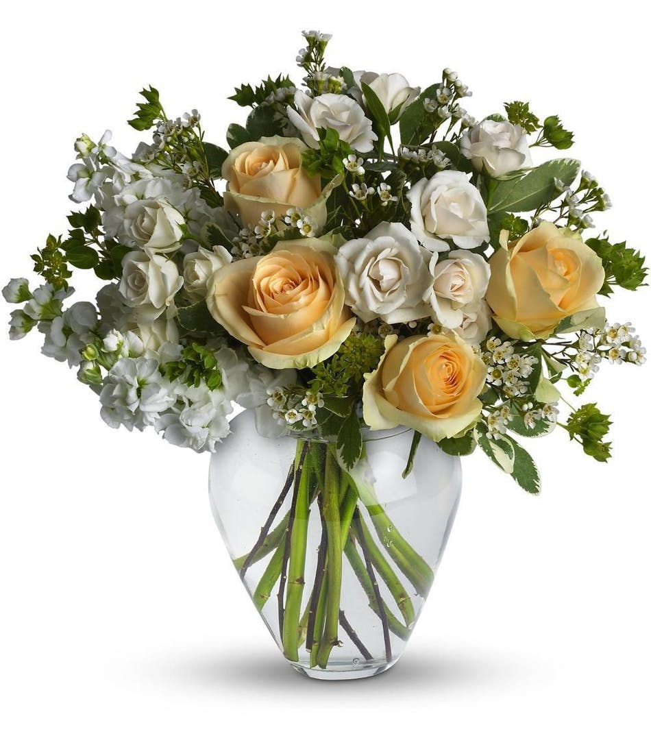 Celestial love hollywood same day flower delivery peach roses creme spray roses white stock and waxflower in a clear glass vase mightylinksfo
