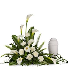 Large white calla lilies pair with white roses and lush greens that include soft, airy sword fern and glossy aspidistra. Approximately 41