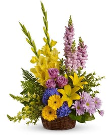 Sympathy basket of blue hydrangea, lavender roses, snapdragons, daisy spray chrysanthemums and more.
