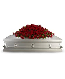 All-red casket spray made entirely of roses.