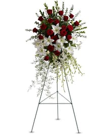 White lily and red rose funeral standing easel spray.