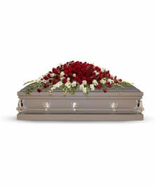 Dramatic red and white casket spray of roses, gladioli and stock.